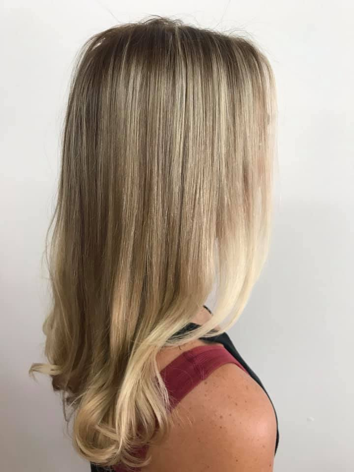 Beautiful blond hair color correction at beauty and the barber hair salon in cocoa beach